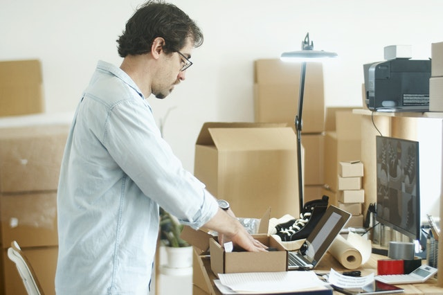 a man compiling an inventory list of items in a self-storage