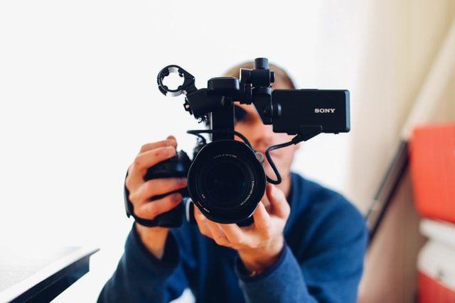 A person recording a video